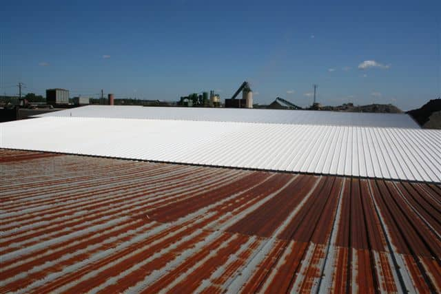 Here is a series of metal roofs that were leaking and causing problems for the items that are stored inside. The new Elastomeric rubber coating system has stopped the leaks and lowers the inside temperature too.