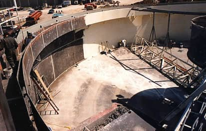 This digester is being stripped of its old coating in preparation for the new.
